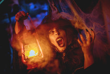 Witch With Lighted Lantern In ...
