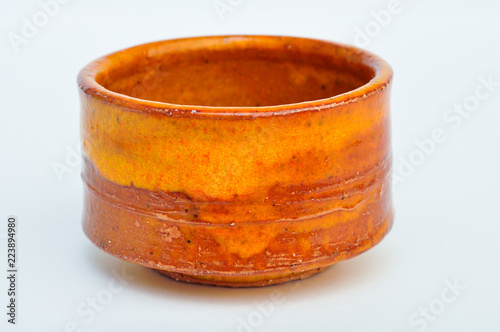 Orange traditional japanese pottery cup
