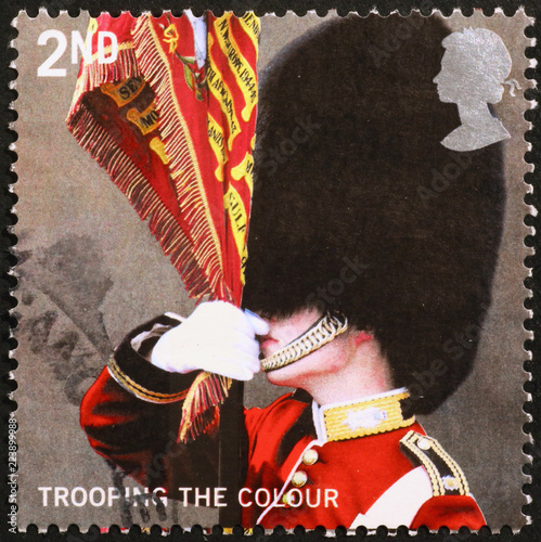 Photo  Portrait of a Queen's guard on british postage stamp