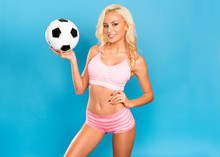 Sexy Blonde With A Soccer Ball. Young Football Cheerleader