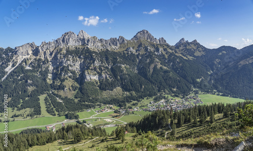 Fotobehang Olijf scenic mountain landscape in the Tannheim Valley, Tirol, Austria with the famous summits of Rote Flueh, Gimpel and Aggenstein