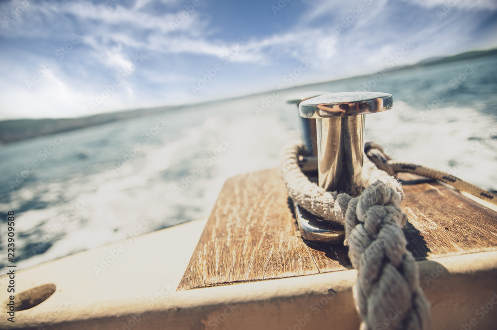 Fototapety, obrazy: Close up of mooring rope on the boat that is sailing on the see
