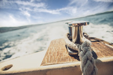Close Up Of Mooring Rope On The Boat That Is Sailing On The See
