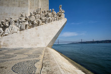 Monument To The Discoveries (Padrao Dos Descobrimentos) At The Tagus River With View On 25th Of April Bridge