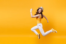 Portrait Of Excited Smiling Young Happy Jumping High Woman In Straw Summer Hat, Copy Space Isolated On Yellow Orange Background. People Sincere Emotions, Passion Lifestyle Concept. Advertising Area.