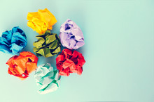 Colorful Crumpled Paper Balls On Blue Background