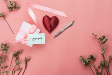 Table Top View Aerial Image Of Love & Valentine's Day Background Concept.Flat Lay Gift With Heart And Flower On Modern Grunge Pink Wallpaper At Home Office Desk Studio.Space For Creative Design.