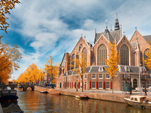 Oude Kerk Over Canal At Spring Day, Amsterdam At Fall, Holland