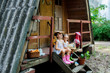 Two beautiful sisters girls read a book on the porch of a house in the village