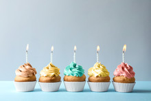 Delicious Birthday Cupcakes With Candles On Light Background