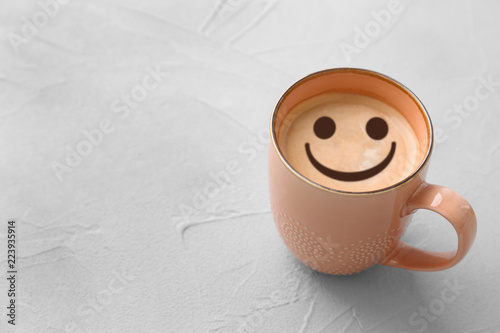 Cup of aromatic hot coffee on light background