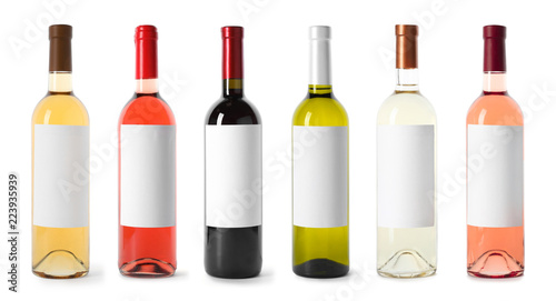 Fototapeta Set with different blank wine bottles on white background. Mock up for design obraz
