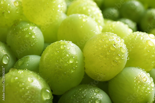Bunch of green fresh ripe juicy grapes as background, closeup