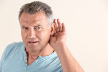 Mature Man With Hearing Proble...