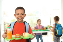 African-American Boy Holding Tray With Healthy Food At School Canteen