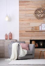 Cozy Furnished Apartment With Niche In Wooden Wall And Armchair. Interior Design