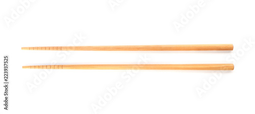 Chopsticks made of bamboo on white background, top view Wallpaper Mural