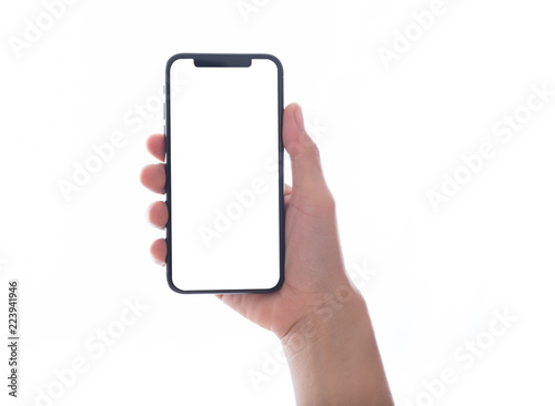 Fotografía  close up hand hold phone isolated on white, mock-up smartphone white color blank