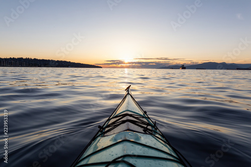 Sea Kayaking during a vibrant sunny summer sunset фототапет