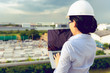 Portrait of engineer woman is using laptop inspection precast concrete product in factory