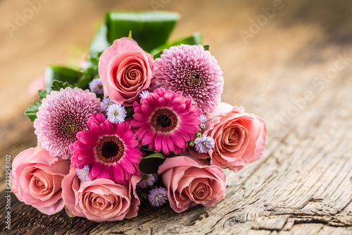 Close-up beautiful bouquet of flowers on wooden table. Fototapeta