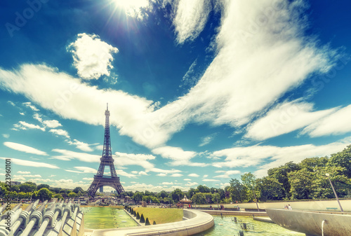 Papiers peints Paris Trocadero Fountains and Eiffel tower on a summer day with dramatic clouds. Travel background.