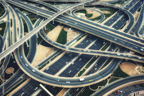 Aerial view of big highway interchange with traffic in Dubai, UAE, at day Fototapete