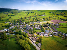 Aerial View Above Houses In An Old British Village In The Countryside. Warm Colours Give A Homely Effect.