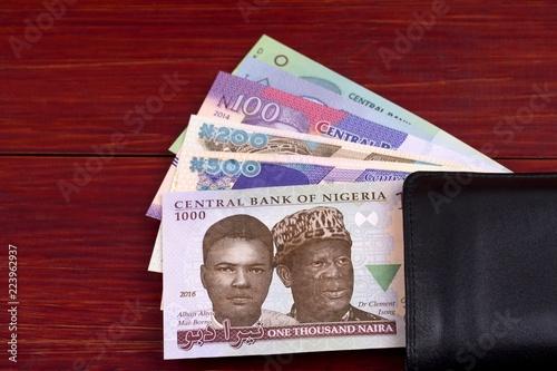 Nigerian Naira in the black wallet Tablou Canvas