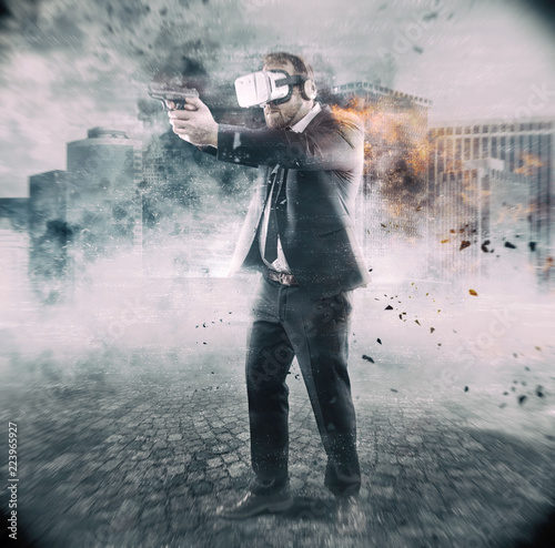 фотографія  Businessman is playing a game wearing virtual reality glasses and holding a gun