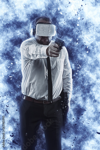 Photo  Businessman is playing a game wearing virtual reality glasses and holding a gun