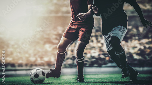 soccer football player red versus blue team competition in the stadium Tablou Canvas
