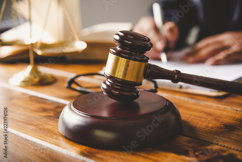 Fotografie, Obraz  Law theme, mallet of the judge, law enforcement officers, evidence-based cases, and documents taken into account