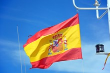 Spanish Flag On A Fishing Boat Against A Blue Sky, Ayamonte, Spain.