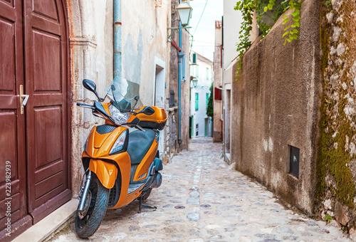Fototapety, obrazy: Scooter in narrow street with stone houses, Croatia
