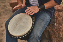 Music Improvisation. Close Up Of Male Hands Playing Music Using Djembe