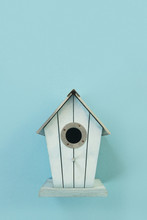 Blue Wooden Bird House On A Wh...