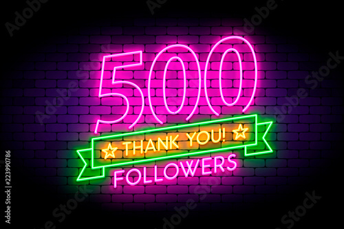 Tela  500 followers neon sign on the wall.