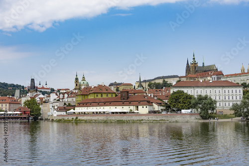 view of castle and charles bridge in prague