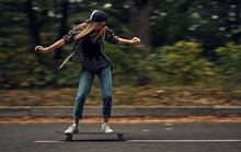 A Girl On A Skateboard Is Ridi...