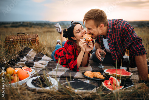 Love couple leisure together, picnic on the meadow