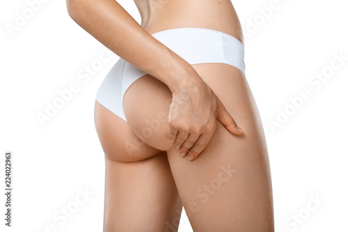 Stampa su Tela Unrecognizable woman in underwear testing fat layer on hips
