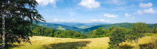 Obraz Wide panorama of a idyllic mountain landscape on a sunny day in the morning - fototapety do salonu