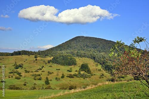 Fotografia  Mountain with green meadow and blue sky in autumn landscape, Low Beskids (Beskid