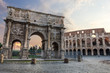 The Colosseum and The Arch of Constantine view with colorful sky and no people