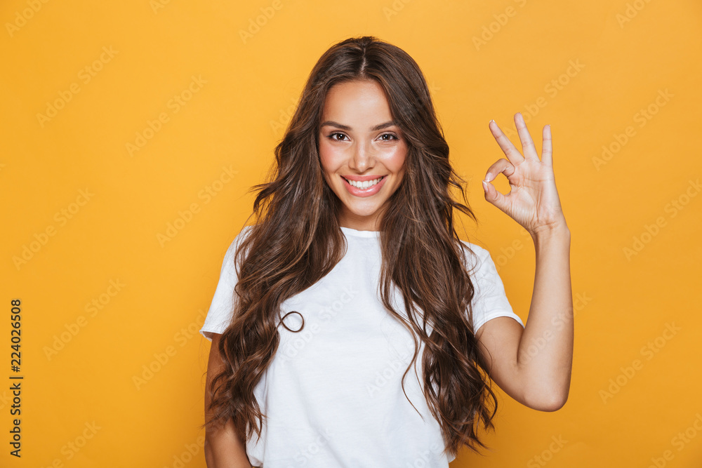 Fototapety, obrazy: Woman isolated over yellow background showing okay gesture.