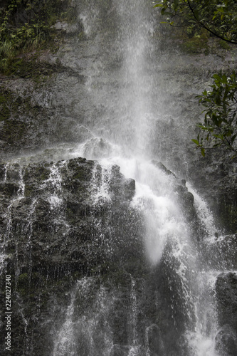 Poster Watervallen Close Up Waterfall Down Cliff in Jungle