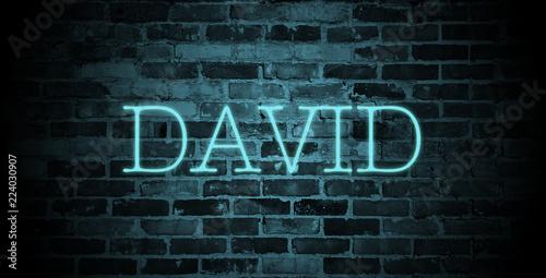 Fotografía  first name David in blue neon on brick wall
