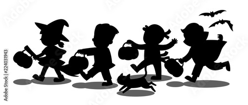 Halloween Trick Or Treat Silhouette.Happy Halloween Silhouette Of Children Dressed In Halloween