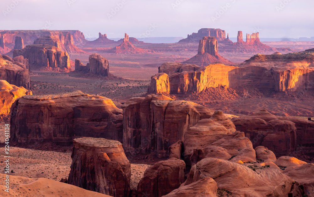 Fototapeta Dramatic buttes in Monument Valley on the Arizona - Utah border, on the Navajo Nation reservation, with dramatic skies and clouds
